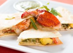 Maine Lobster and Mango Quesadilla with Tomatillo Salsa. Maine lobster puts a fun twist on this fan-favorite Mexican dish.