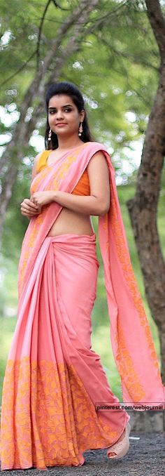 Coral pure georgette saree with gingko leaf embroidery from eastandgrace.com