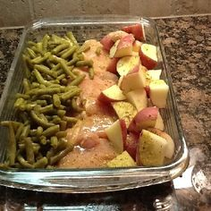 4 raw chicken breasts, new potatoes, green beans. Arrange in 9x13 dish. Sprinkle with a packet of Italian dressing mix and then top with a melted stick of butter. Cover with foil and bake at 350 degrees for 1 hour.
