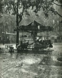 Robert Doisneau, carrousel at square de l'Aspirant-Dunand, 1952.
