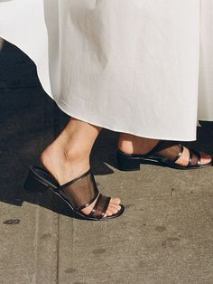 With the hot weather still going strong, we can't help but covet more sandals, especially when we come across a style this cool. Our editors are already decked out (or coveting) simple, low-heeled mule sandals, but these have an edgy twist: mesh.