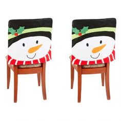 One of my favorite discoveries at ChristmasTreeShops.com: Red Scarf Snowman Chair Covers, Set of 2