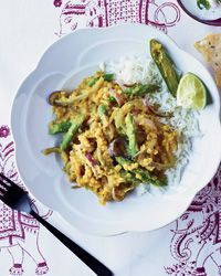 Red Lentil Dal with Tamarind and Asparagus - intriguing balance of tartness from tamarind and lime, and sweetness from slow-cooked onions.