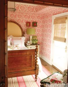 A Pretty Guest Room  Designer Healing Barsanti used an antique barley-twist bed in this guest room. The wallpaper is GP Baker's Poppies.