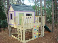 A raise playhouse with a slide and climbing wall.