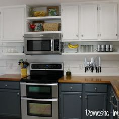Love the open shelves under cabinets that go to the ceiling!