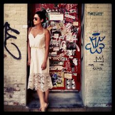 Shay Mitchell's lace dress looks wonderful popped against the graffiti