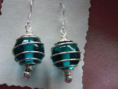 Sterling Silver ear wires and a silver plated cage containing a beautiful large jade green glass bead with a silver bead at the base