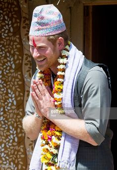 Prince Harry is given a Topi, a traditional Nepalese hat, at Danna homestay village on day three of his visit to Nepal on March 21, 2016 in Bardia, Nepal. Prince Harry is on a five day visit to Nepal, his first official tour of the country. (Photo by Paul Edwards - Pool/Getty Images)
