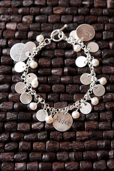 I love this Ultimate Customizable Mother's bracelet. The children's names surrounded by tiny sterling silver discs and pearls. #mothers day #gift idea #for mom