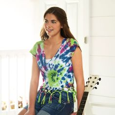 Nothing screams summer like a DIY Tie Dye Fringe Shirt. Add fringe for flirty fun and be ready for music festival season.