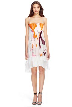 This romantic tiered dress stuns with layers of white chiffon, a printed inset and the most delicate straps. A versatile option for summer occasions. Debuted on the Riviera runway on supermodel Naomi Campbell. Can be worn with or without white tie belt. Concealed back zip and structured interior bodice. Falls to mid thigh. Fit is true to size.