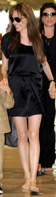 Angelina Jolie on Black Satin Casual Mini Skirt, Flop, and Aviator