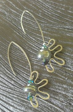 Silver handmade earrings with snazzybeads bead. Perfect for special nights out.