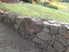 How to Build a Natural Dry Stacked Stone Free Standing or Retaining Rock Wall : 4 Steps (with Pictures) - Instructables Dry Stack Stone, Stacked Stone Walls, Dry Stone, Stacked Stones, Small Retaining Wall, Rock Retaining Wall, Building A Retaining Wall, Landscaping With Rocks, Backyard Landscaping
