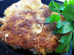 Pork Chops Milanese - These savory bone-in pork chops are rich and buttery with just a touch of fresh lemon juice brightening every juicy bite, accentuated by the tang of Parmesan cheese.
