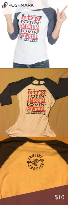 """Cowgirl Justin Women's Gun Totin' Baseball T Sz M Show your true tough girl attitude with this adorable western style tee shirt from Cowgirl Justice. The vintage inspired baseball tee shirt is white with a navy blue ringer crew neck and raglan sleeves. The front has a red and blue screen printed design of stars and arrows. The phrase """"Gun Totin' America Lovin' Cowgirl' is well displayed showing your southern roots. Cowgirl Justice  Tops Tees - Long Sleeve"""