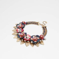Aldo Thadowia. Floral sequin applique makes quite the statement on this necklace. Faux pearls dot the bouquet for a sweet finish.. DETAILS: Silhouette: Necklace