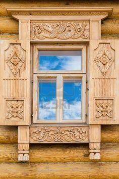 http://us.123rf.com/400wm/400/400/irynarasko/irynarasko1207/irynarasko120700011/14585886-wooden-decorated-window-in-log-house-russian-traditional-architecture.jpg
