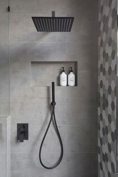 In this modern bathroom, the shower has a matte black rainfall shower head and a hand held shower head, as well as a tiled built-in shelf. - In this modern bathroom, the shower has a matte black rainfall shower head and a. Bad Inspiration, Bathroom Inspiration, Bathroom Ideas, Bath Ideas, Bathroom Organization, Bathroom Renovations, Bathroom Storage, Bathroom Layout, Bathroom Shelves