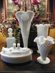 Milk Glass  Love the Art Deco piece in the center - it must be a rare piece.
