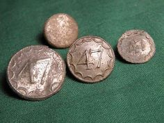 47th British Regiment of Foot Buttons found in a 1777 Burgoyne camp sight.