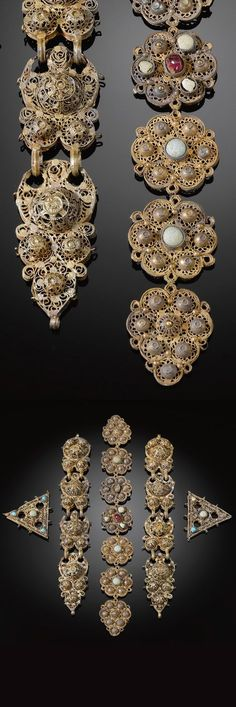 Persia - Seljuk   Group of gold filigree jewellery; two bracelets of interlinking design decorated with openwork filigree, one bracelet composed of seven openwork flowerheads mounted with polychrome stones, and two triangular pendants worked in filigree a