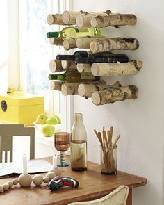 #Diy #wine #rack: Take a handful of tree branches and screw them on the wall to create a wine rack with an outdoor feel.
