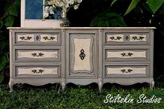 Stiltskin Studios.bs (9/23/12)  Paris Grey and Old White, with Cracqueleur finish in center of each drawer, with maybe a dark wax glaze?