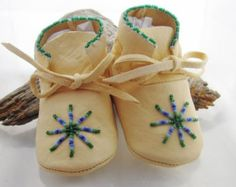 Native American Moccasins / Baby Moccasins / Boys Shoes / Moccasins / boys / girls / soft soled shoes /moccs / mocs /Genuine Leather Moccasins   These would make a unique one of a kind Christmas gift for that special someone in your life. Authentic Native Made beaded baby moccasins are painstakingly hand beaded and are suitable as the next family heirloom.   ***The material is an incredibly soft supple deer hide that will stretch to fit your babys foot as he grows. Deerskin is more…