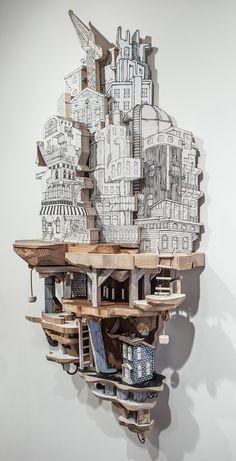 Luke O'sullivan combina dibujos serigrafiados sobre madera y metal para crear estas esculturas arquitectónicas con una doble realidad, la ciudad sobre el suelo y la que vive en las alcantaril…