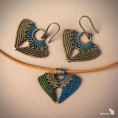 Set of macrame earrings and pendant with leather cord. Made with Linhasita 0,5 mm thread, glass seed beads and silver 24K gold plated beads. Size of the earrings: L- 45mm (including earwires) W- 32mm Size of pendant: L- 25mm W- 32mm