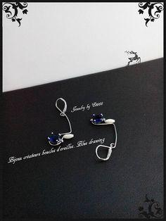 Bijoux créateurs boucles d'oreilles. Blue drawing