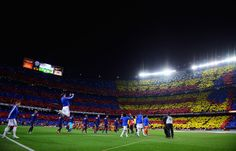 Players and officials walk onto the pitch prior to the La Liga match between FC Barcelona and Real Madrid CF at Camp Nou on March 22, 2015 in Barcelona, Catalonia.