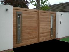 modern wooden gate http://www.pinterest.com/avivbeber3/modern-garage-door-and-gates/