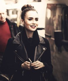 Lily Collins (leather jacket, hair, makeup, scarf, rings)