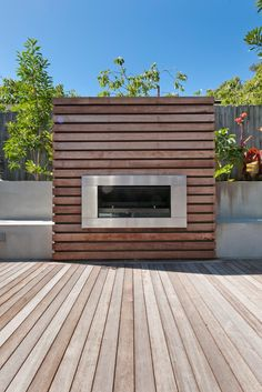 Outdoor Gas Fire \ Beautiful handcrafted timber fireplace with stainless steel grate.