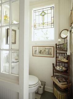 I like the stained glass in the window. cottage style bathroom, lovely!