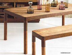 Roost Recycled Mahogany Dining Table - Clean, modern lines pair with aged wood to create this rustic yet refined collection of substantial pieces. Made from distressed planks of solid mahogany, the console has four fixed shelves and the table and bench are framed in artfully pitted recycled iron.