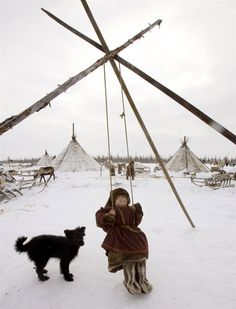 A Nenets boy sits on a swing at his settlement in the Tundra region near village of Yar-Sale, located in the Yamal peninsula above the polar circle, some 1336 miles northeast of Moscow, February 25, 2008. The Nenets are indigenous people in Russia's artic region north of the Urals.