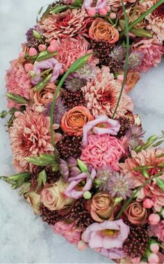 A detailed funeral wreath in orange, coral and peach using roses, dianthus, hypericum, astrantia and chrysanthemum Diy Sympathy Flower Arrangements, Sympathy Flowers, Floral Arrangements, Diy Wreath, Wreaths, Funeral Sprays, Funeral Planning, Astrantia, Create Picture