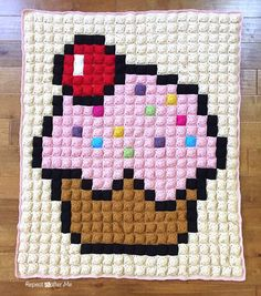The masterpiece is complete! Here is my Crochet Cupcake Pixel Blanket! Phew, it's finally finished and I am really happy with the way it turned out. Let me tell you all about it and walk you through all the steps so you can make your own! I will try to answer some frequently asked questions …