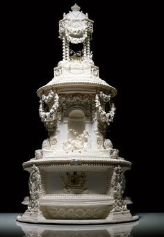 Queen Victoria commissioned the original tiered wedding cake. Before that, couples would kiss over a tall pile of iced buns for good luck. In 1858, Queen Victoria's daughter Princess Victoria commissioned the first columned wedding cake modeled after the elaborate spire atop of London's St. Bride's Church. She married Frederick William of Prussia. A team of 4 people worked for 7 days to craft this 42-inch tall masterpiece.
