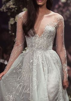 Love the subtle embroidered words on this gown by Paolo Sebastian