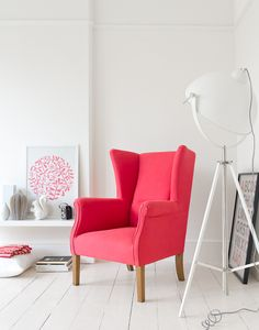 Pink arm chair / white interior