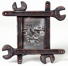 Photoframe: This tool photoframe measures 9-1/2-inch by 1-inch by 9-1/2-inch high and you can place a photo that is 4-inch by 6-inch.