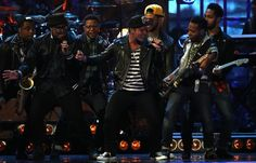 Bruno Mars, winner of the award for International Male Solo Artist, performs on stage at the BRIT Awards 2014 at the O2 Arena in London on W...