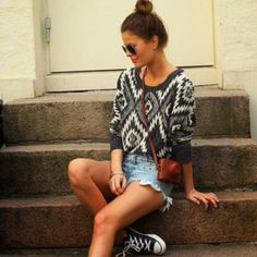 sweater tucked into denim high-waisted shorts with sneakers