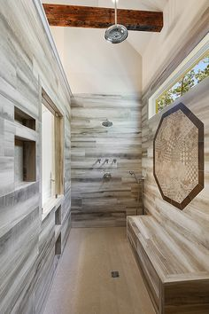 This custom tiled walk in shower is a true vertical spa with multiple shower heads and a large bench for true comfort and relaxation. Tile Walk In Shower, Dream Shower, Walk In Shower Designs, Master Shower, Master Bathroom, Rain Shower, Shower Installation, Luxury Shower, Revere Pewter