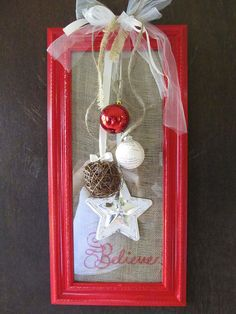 "Here's another frame wreath idea. I like the ""Believe"" written on the burlap inside the frame."